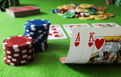 7005252-chips-and-ace-king-hand-on-a-gambling-table
